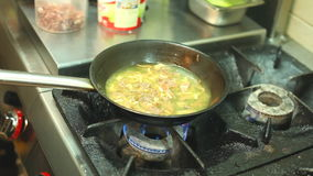 Frying vegetables in pan stock video