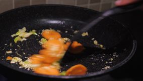 Frying vegetables in a pan stock video footage