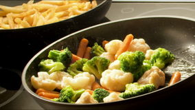 Frying vegetables Stock Image