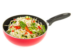 Frying wok pan with vegetables Stock Photography