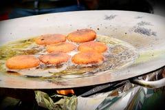 fryingof Aloo Tikki chaat, india snack food. royalty free stock photography