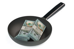 Frypan with dollars Stock Image