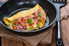 Frypan with Ham and Cheese Omelette Stock Photos