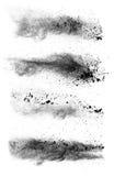 Frysa rörelse av svarta dammexplosioner på vit bakgrund arkivbild