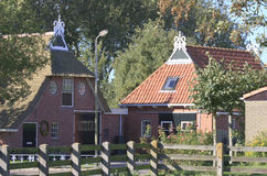 Frysian houses with owl boards in the Netherlands royalty free stock image