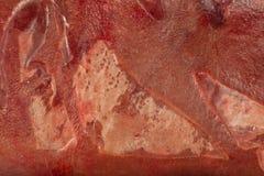 Fryst ny nötköttlever i kvarter, textur av djupfryst lever royaltyfri bild