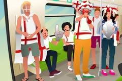 Fãs de futebol que viajam pelo trem Imagem de Stock