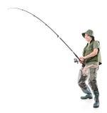 Fsherman che tiene una canna da pesca Immagini Stock Libere da Diritti