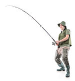 Fsherman holding a fishing pole Royalty Free Stock Images