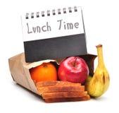 fästande ihop lunchbanatid Arkivbild
