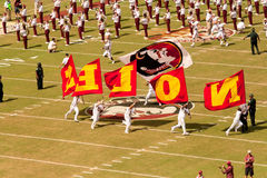 FSU Football Game. TALLAHASSEE, FLORIDA - SEPTEMBER 26:  The Marching Chiefs, cheerleaders and players prepare for a Florida State football game in Doak Campbell Royalty Free Stock Photos