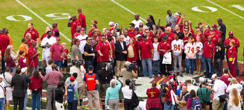 FSU Homecoming. Tallahassee, FL - Nov. 16, 2013: Bobby Bowden, with his wife Ann, gather at midfield with the 1993 National Championship Team during the 2013 Royalty Free Stock Photos