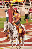 FSU's Chief Osceola. Tallahassee, Florida - October 27, 2012:  Chief Osceola, riding Renegade, gets the crowd going prior to the football game between Florida Royalty Free Stock Photography