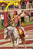 FSU's Chief Osceola Riding Renegade. Tallahassee, Florida - October 27, 2012:  Chief Osceola, riding Renegade, gets the crowd going prior to the football game Stock Image