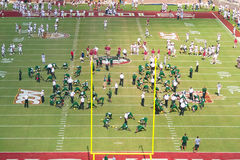 FSU and USF Football Teams Warm Up. Tallahassee, FL - Sept. 26, 2009:  Pre-game warm ups for both Florida State Seminoles and South Florida Bulls at Doak Royalty Free Stock Photo