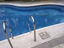 4ft condo community pool. Not too deep pool in a midrise condo community compound stock photography