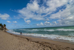 Ft. Lauderdale beach. With only one person on the beach. Blue skies with white puffy clouds Stock Image