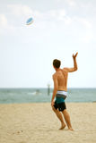 Man Throws Frisbee On Florida Beach. Ft. Lauderdale, FL, USA - December 29, 2012:  An unidentified man throws a frisbee on the beach of a Ft. Lauderdale resort Royalty Free Stock Image