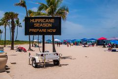 This is a sign on a beach on a hot summer day warning that it is hurricane season and that. Ft. Lauderdale, Florida - July 8, 2018: This is a sign on a beach on stock photography