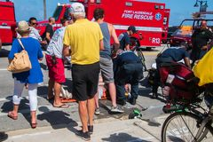 Ft Lauderdale, Florida - May 4, 2019: Paramedics and police officers attend to woman who was injured when she lost control of her royalty free stock image