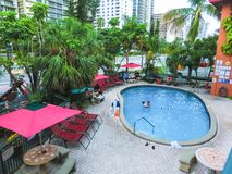 Ft.Lauderdale, USA - May 12, 2018: Ft.Lauderdale Beach Resort Hotel and suites. Ft.Lauderdale, USA - May 12, 2018: The swimming pool at Ft.Lauderdale Beach royalty free stock image