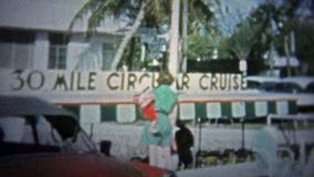 FT. LAUDERDALE, USA - 1957: Mom and child waiting to get on the popular 30 mile tourism cruise. stock video footage
