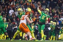 Fútbol del NCAA - Oregon en el estado de Oregon Foto de archivo libre de regalías