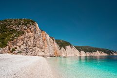 Free Fteri Beach In Kefalonia Island, Greece. One Of The Most Beautiful Untouched Pebble Beach With Pure Azure Emerald Sea Stock Image - 124086991