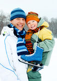 Fther and son go ice skating. Happy family, young father going ice skating with his little son Stock Image