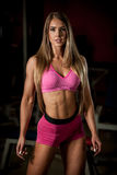 Ftiness woekout - Popular beautiful aoung woman workout in fitne Royalty Free Stock Photography