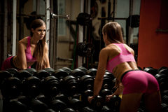 Ftiness woekout - Popular beautiful aoung woman workout in fitne Stock Photography