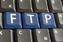 FTP written on computer keyboard. FTP written with blue keys on computer keyboard royalty free stock images