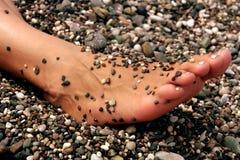 Fuß auf dem Strand lizenzfreies stockfoto
