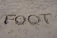 Fuß auf Sand Lizenzfreies Stockbild