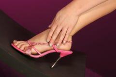 Fuß in der Hand Stockfotos