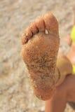 Fuß im Sand Stockfoto