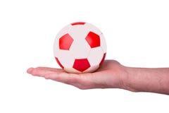 Fußball auf einer Hand Lizenzfreies Stockfoto