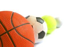 Fußball, Basketball, tennisball und Golfball innen Lizenzfreies Stockfoto