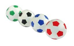 Fußball in der Reihe an flachem DOF Stockfotos