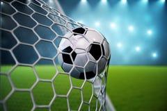 Fußball der Wiedergabe 3d im Ziel Fußball im Netz mit hellem Hintergrund des Scheinwerfers und des Stadions, Erfolgskonzept Lizenzfreies Stockbild