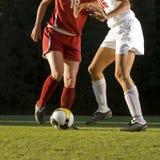 Fußball-Füße u. Kugel Lizenzfreie Stockbilder