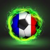Fußball-Flagge von Frankreich in einer grünen Flamme Stockfotos
