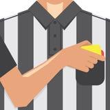 Fußball-/Fußball-Schiedsrichter Showing Yellow Card von der Tasche Stockfoto