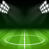 Fußball-Hintergrund mit Lichtern des hellen Flecks Stockfotos