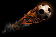 Fußball im Feuer Stockfotos