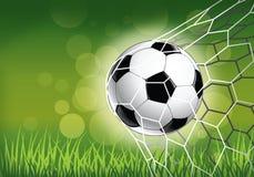 Fußball im Netz mit Hintergrund Lizenzfreie Stockfotografie