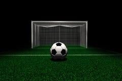 Fußball im vorderen Ziel lizenzfreies stockbild