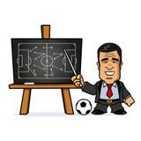 Fußball-Manager, der auf Tafel zeigt Stockfotografie