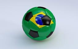 Fußball mit Brasilien-Flagge Lizenzfreies Stockfoto