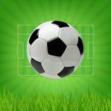 Fußball-oder des Fußball-3d Ball auf grünem Hintergrund Lizenzfreie Stockfotos